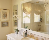Master bath with Crema Marfil marble and mirrored silk window treatment - traditional - bathroom - los angeles