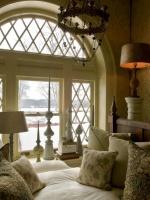 Beige Storybook Children's Room with Arched Window and White Bedding : Designers' Portfolio